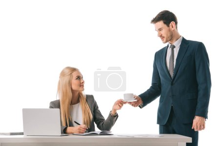 male secretary brought cup of coffee for professional businesswoman at workplace with laptop, isolated on white