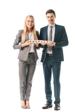 Photo for Smiling businesspeople in suits holding alphabet cubes with equality word, isolated on white - Royalty Free Image
