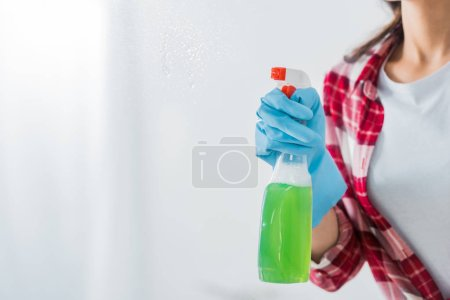 Photo for Partial view of african american woman holding spray bottle on white background - Royalty Free Image