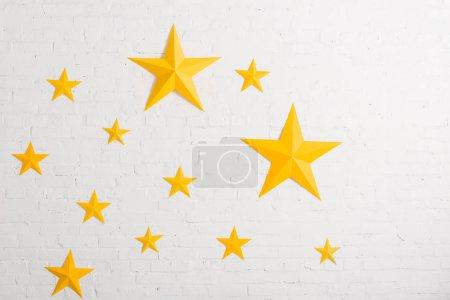 Yellow cardboard stars on light textured background