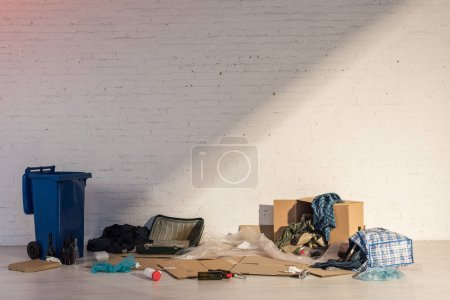 Photo for Blue trash container and rubbish dump on brick wall background - Royalty Free Image