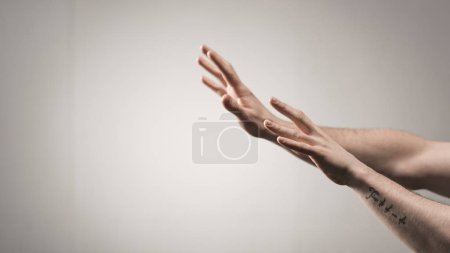 Photo for Partial view of male hands with tattoo on grey background - Royalty Free Image