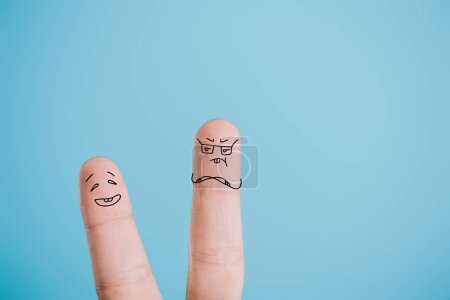 cropped view of funny couple of fingers isolated on blue
