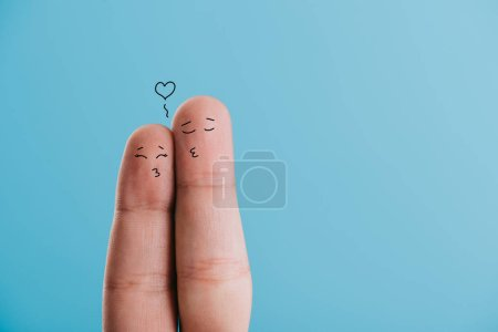Photo for Cropped view of loving couple of fingers kissing isolated on blue - Royalty Free Image
