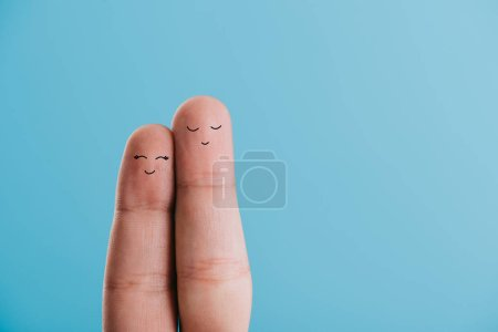 cropped view of happy couple of fingers isolated on blue