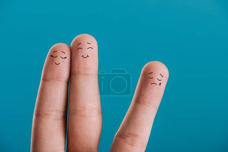 cropped view of fingers as happy couple in love and third wheel isolated on blue