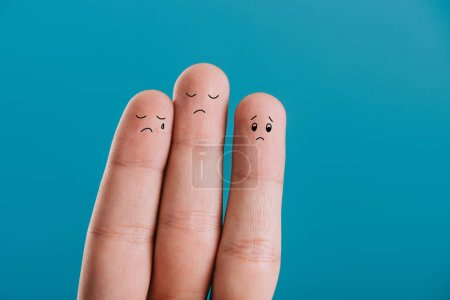 Photo for Cropped view of upset human fingers crying isolated on blue - Royalty Free Image