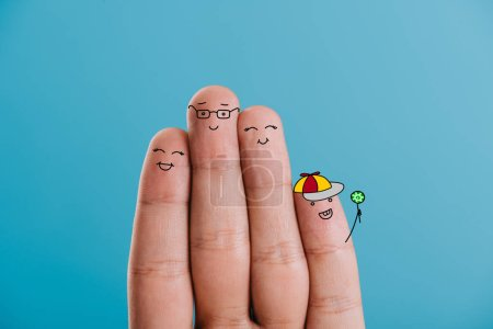 Photo for Cropped view of cheerful fingers family isolated on blue - Royalty Free Image