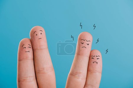Photo for Cropped view of fingers as confused and angry couples isolated on blue - Royalty Free Image