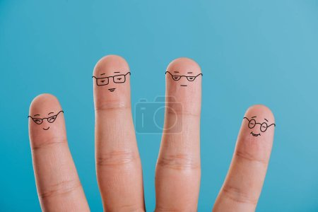 Photo for Cropped view of human fingers in eyeglasses isolated on blue - Royalty Free Image