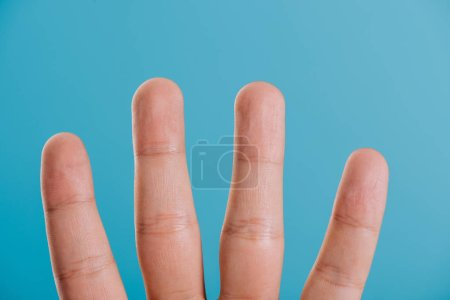 Photo for Cropped view of human fingers isolated on blue - Royalty Free Image