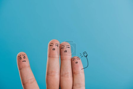 Photo for Cropped view of fingers taking selfie isolated on blue - Royalty Free Image