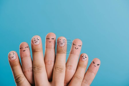 Photo for Cropped view of human fingers with different emotions isolated on blue - Royalty Free Image