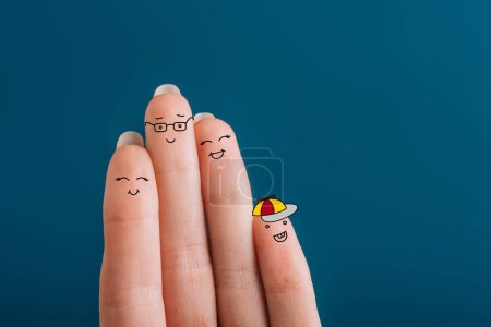 Photo for Cropped view of smiling fingers family isolated on blue - Royalty Free Image