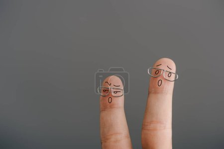 Photo for Cropped view of shocked fingers in eyeglasses isolated on grey - Royalty Free Image