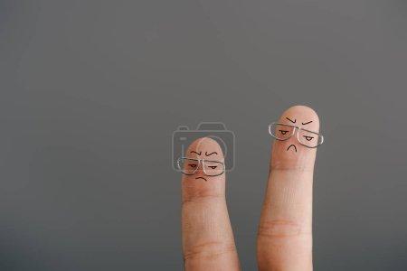 Foto de Vista recortada de dedos insatisfechos en vasos aislados en gris - Imagen libre de derechos