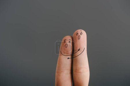 cropped view of frightened couple of fingers hugging and screaming isolated on grey