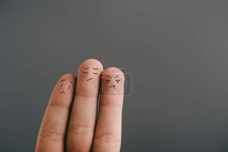 Photo for Cropped view of worried human fingers isolated on grey - Royalty Free Image