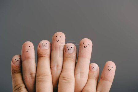 Photo for Cropped view of fingers with different emotions isolated on grey - Royalty Free Image