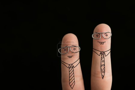 Photo for Cropped view of fingers as angry businessmen in ties and glasses isolated on black - Royalty Free Image
