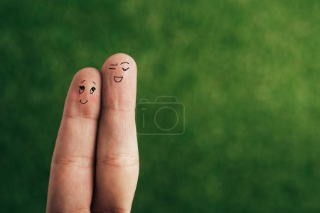 Photo for Cropped view of smiling couple of fingers on green - Royalty Free Image
