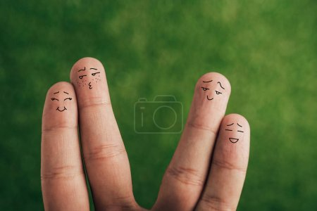 Photo for Cropped view of human fingers as positive couples on green - Royalty Free Image