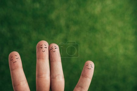 Photo for Cropped view of happy human fingers on green - Royalty Free Image