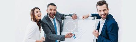 Photo pour Collègues debout près de stand avec document et sourire isolé sur blanc - image libre de droit