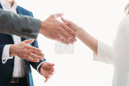 Photo for Selective focus of men and woman shaking hands at office - Royalty Free Image