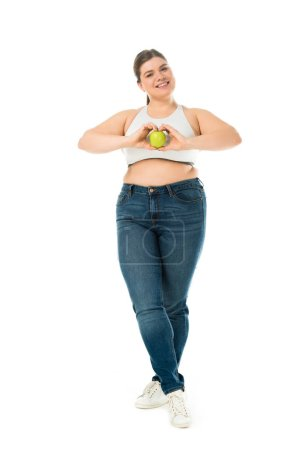 Photo for Happy smiling overweight woman holding green apple isolated on white - Royalty Free Image