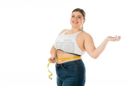 Photo for Smiling overweight woman measuring waist with measuring tape isolated on white, body positivity concept - Royalty Free Image