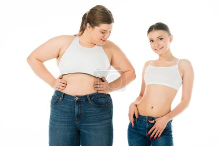 Photo for Slim and overweight women in denim posing together isolated on white, body positivity concept - Royalty Free Image