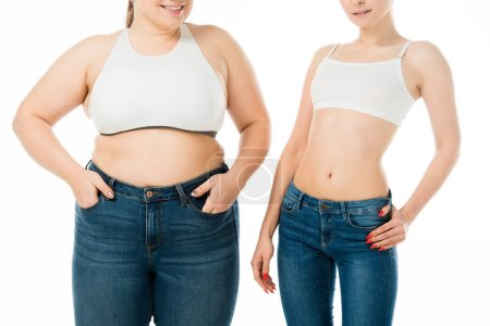 Photo for Cropped view of smiling slim and overweight women in denim posing together isolated on white, body positivity concept - Royalty Free Image