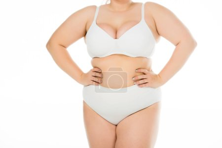 Photo for Cropped view of overweight woman in underwear with hands on hips isolated on white, body positivity concept - Royalty Free Image
