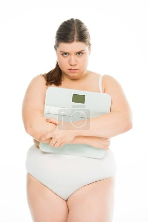 Photo for Upset young overweight woman holding scales isolated on white, lose weight concept - Royalty Free Image