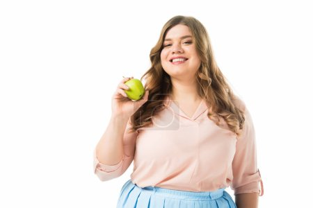 Photo for Happy overweight woman holding green apple isolated on white - Royalty Free Image