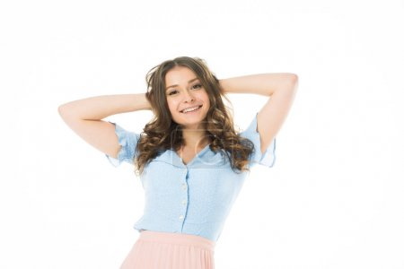 Photo for Pretty smiling girl posing with hands on head isolated on white - Royalty Free Image