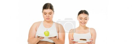 Photo for Happy slim and sad overweight girls holding plates with doughnut and green apple isolated on white - Royalty Free Image