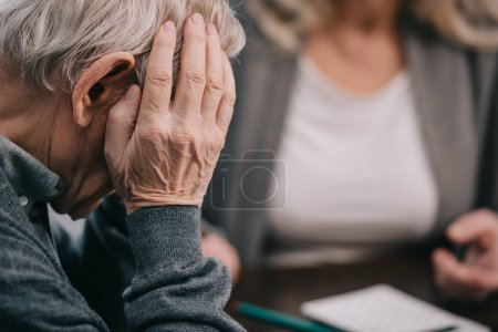 Photo for Selective focus of senior man with hand on head having headache - Royalty Free Image
