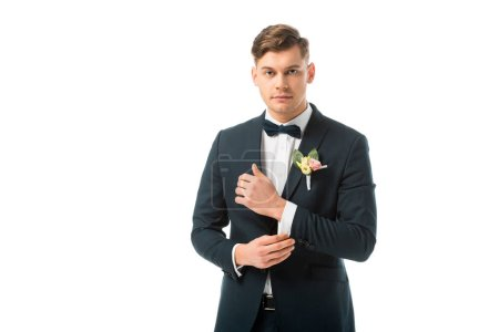 Photo for Confident handsome bridegroom in black elegant suit isolated on white - Royalty Free Image
