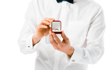 Photo for Selective focus of groom showing gift box with wedding ring isolated on white - Royalty Free Image