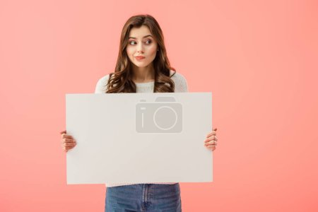 beautiful woman holding empty board with copy space isolated on pink