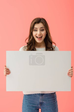 Photo for Happy and beautiful woman holding empty board with copy space isolated on pink - Royalty Free Image