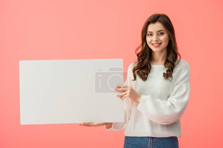 Photo for Smiling and beautiful woman holding blank placard with copy space isolated on pink - Royalty Free Image