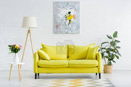 Photo for Interior of modern white living room with decor and bright yellow sofa - Royalty Free Image
