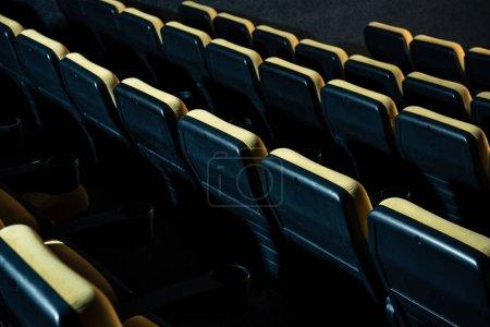 rows of comfortable plastic empty seats in cinema hall
