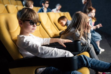 Photo for Multicultural friends in 3d glasses sitting in comfortable seats in cinema - Royalty Free Image