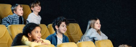 Photo for Panoramic shot of multicultural friends spending time in cinema together - Royalty Free Image