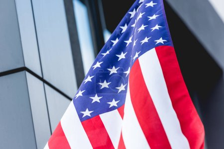 Photo for National american flag with stars and stripes near building - Royalty Free Image