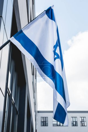 Photo for Low angle view of national israel flag near building - Royalty Free Image